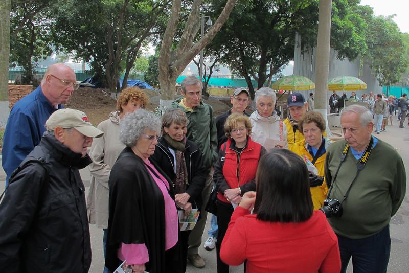 Our tour group huddles at the Ho Chi Minh mausoleum.  Arnie Kaston, Burt Rein, Lynn Kasten, Linda Weber, Susan Rein, Ray Cabano, Fran Aronowitz, Mark Aronowitz, Erma Cabano, Sam Solomon, Linda Shyawitz, Harry Weber.