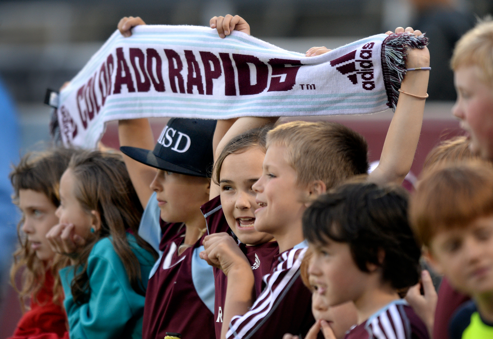 . Young fans watched the team warm up before the game. The Colorado Rapids hosted the Montreal Impact Saturday night, May 24, 2014. (Photo by Karl Gehring/The Denver Post)