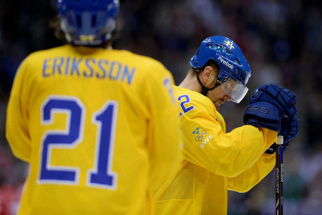 . Daniel Sedin (22) of Sweden hangs his head after the third period of Canada\'s 3-0 win in the men\'s ice hockey gold medal game against Sweden. Sochi 2014 Winter Olympics on Sunday, February 23, 2014 at Bolshoy Ice Arena. (Photo by AAron Ontiveroz/ The Denver Post)