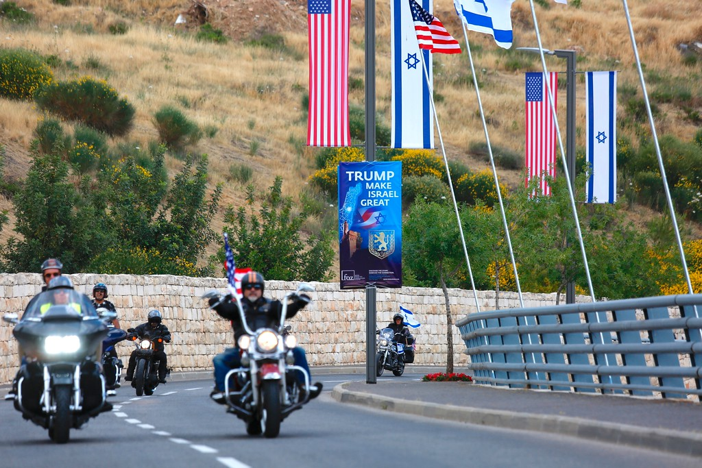 . Riders from the Samson Riders, an Israeli motorcycle club, arrive on a road leading to the new U.S. Embassy during a group ride from the old embassy in Tel Aviv, ahead of the official opening, in Jerusalem, Sunday, May 13, 2018. On Monday, the United States moves its embassy in Israel from Tel Aviv to Jerusalem, the holy city at the explosive core of the Israeli-Palestinian conflict and claimed by both sides as a capital. (AP Photo/Ariel Schalit)