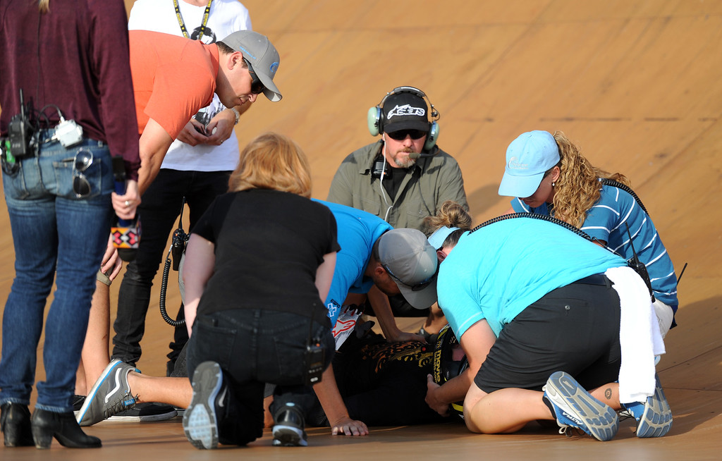 . Xgame personnel looks over Steve McCann after he crashed on his first run and would not return during the GoPro BMX Big Air Final at Irwindale Speedway on Friday, Aug. 2, 2013 in Irwindale, Calif. Morgan Wade won the gold medal.  (Keith Birmingham/Pasadena Star-News)