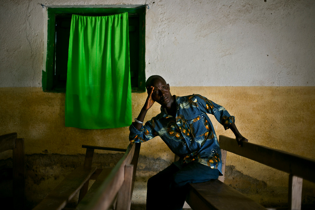 . In this photo taken Thursday Nov. 20, 2014, Isaac Ouamouno sits in the church in the Guinean village of Meliandou, some 400 miles (600 kms) south-east of Conakry, Guinea, believed to be Ebola\'s ground zero.  (AP Photo/Jerome Delay)