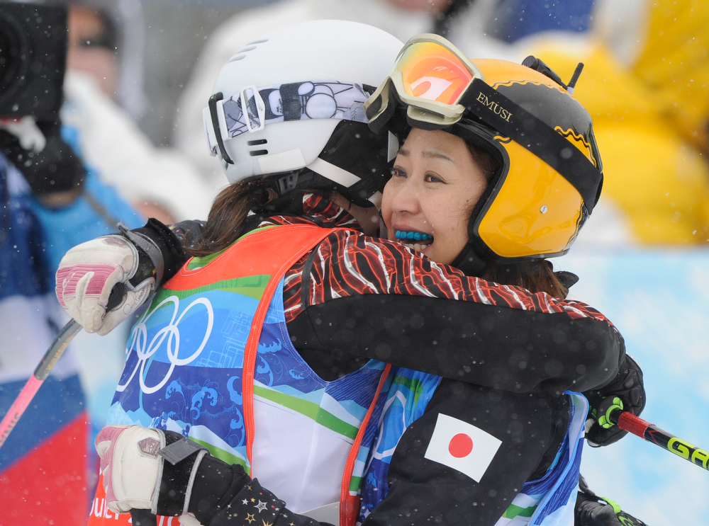 . Fukushima Noriko of Japan, right embrace Kelsey Serwa of Canada after competing in the women\'s skicross 8th final at the Vancouver 2010 Olympics in Vancouver, British Columbia, Monday, Feb. 22, 2010. (AP Photo/Mark J. Terrill)