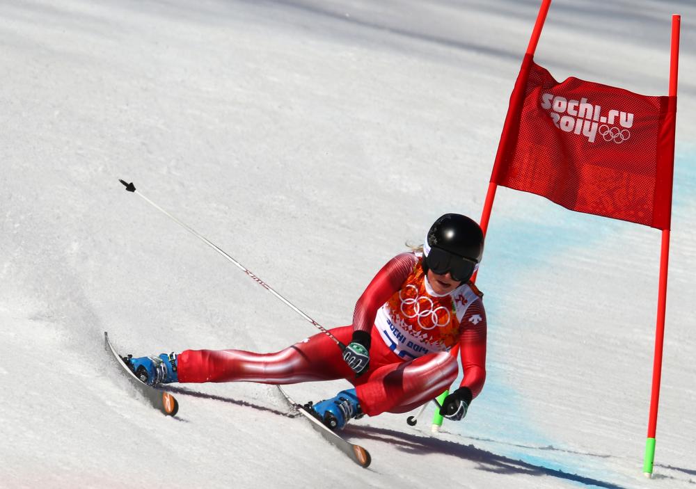 . Switzerland\'s Lara Gut makes a turn in the women\'s super-G at the Sochi 2014 Winter Olympics, Saturday, Feb. 15, 2014, in Krasnaya Polyana, Russia.(AP Photo/Alessandro Trovati)