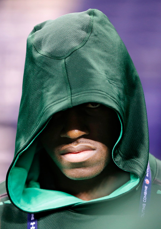 . Harvard defensive lineman Zack Hodges listens to instructions before drills at the NFL football scouting combine in Indianapolis, Sunday, Feb. 22, 2015. (AP Photo/Julio Cortez)