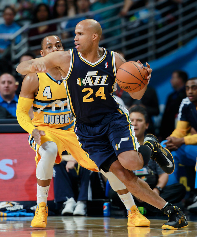 . Utah Jazz forward Richard Jefferson, front, works inside for a shot past Denver Nuggets guard Randy Foye in the first quarter of an NBA basketball game in Denver on Saturday, April 12, 2014. (AP Photo/David Zalubowski)