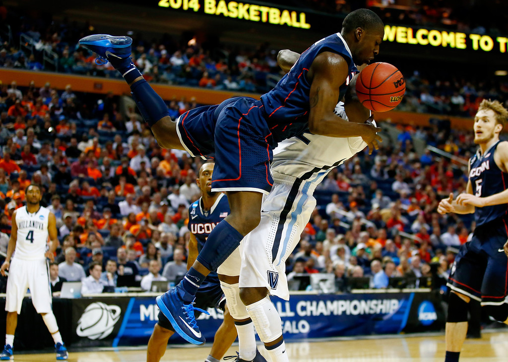 . BUFFALO, NY - MARCH 22:  Terrence Samuel #3 of the Connecticut Huskies collides with JayVaughn Pinkston #22 of the Villanova Wildcats during the third round of the 2014 NCAA Men\'s Basketball Tournament at the First Niagara Center on March 22, 2014 in Buffalo, New York.  (Photo by Jared Wickerham/Getty Images)