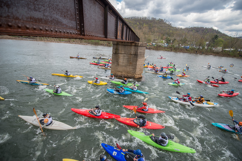 NCM15010; 150501; 2450; Allegheny Trail; Cheat Fest; Cheat River; Cheat River Festival; Events; Friends of the Cheat; Gabe DeWitt; TNC; The Nature Conservancy; The Nature Conservancy Magazine; West Virginia; photo by Gabe DeWitt; spring The Down River Race. The mass start of the race, seen from the old bridge that extends half way across the river.