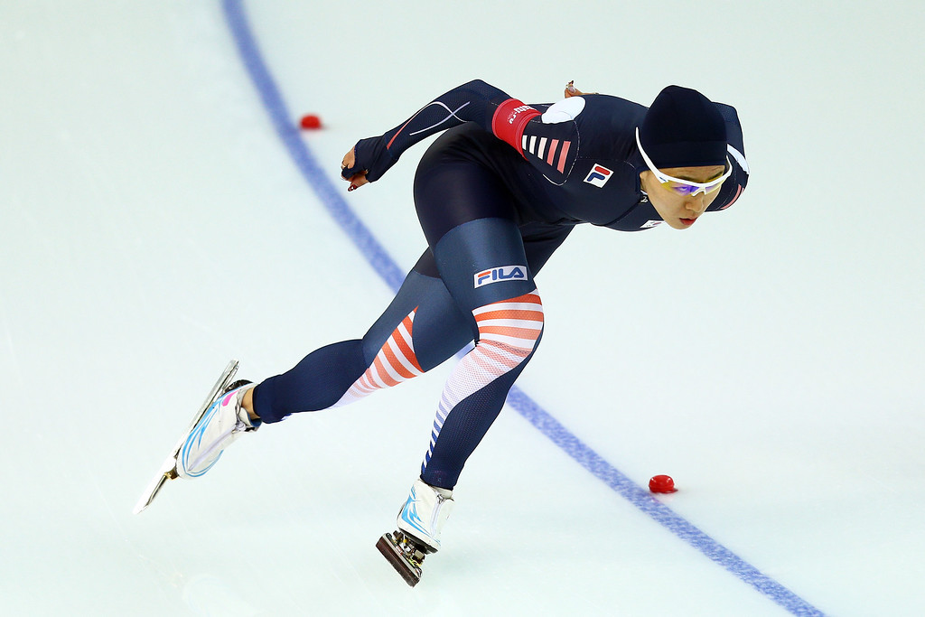. Sang Hwa Lee of South Kroea competes during the Women\'s 1000m Speed Skating event on day 6 of the Sochi 2014 Winter Olympics at Adler Arena Skating Center on February 13, 2014 in Sochi, Russia.  (Photo by Clive Mason/Getty Images)