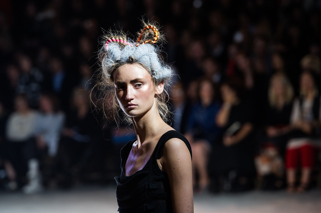 . A model wears a creation for designer Yohji Yamamoto ready-to-wear Spring/Summer 2014 fashion collection, presented in Paris, Friday, Sept.27, 2013. (AP Photo/Zacharie Scheurer)