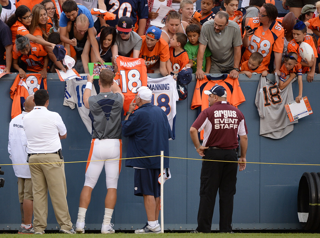 . DENVER, CO. - August 03: Peyton Manning of Denver Broncos (18) signs autographs for his fans at Sports Authority Field at Mile High. Denver, Colorado. August 03, 2013. (Photo By Hyoung Chang/The Denver Post)