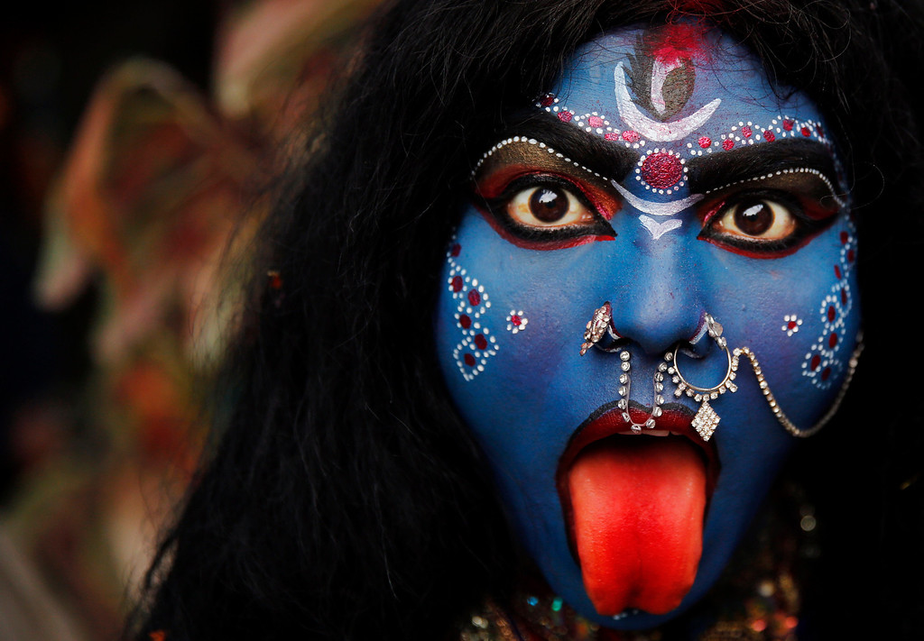""". An Indian woman dressed as Hindu Goddess Kali participates in a \'Shivratri\' procession in Allahabad, India, Thursday, Feb. 27, 2014. \""""Shivaratri\"""", or the night of Shiva, is dedicated to the worship of Lord Shiva, the Hindu god of death and destruction. (AP Photo/Rajesh Kumar Singh)"""