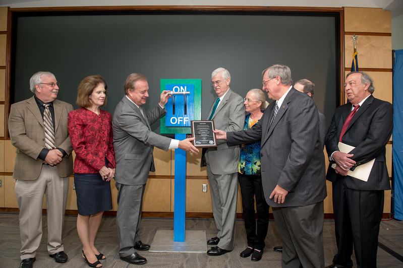 Chancellor John Sharp(left) receives a plaque presented to commemorate the occasion.