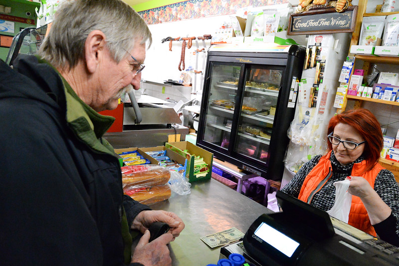 02/28/19  Wesley Bunnell   Staff  Former New Britain Mayor Lucian Pawlek, L,  is waited on by Zieleniak Deli co owner Beata Rulka while purchasing his paczki on Fat Thursday.
