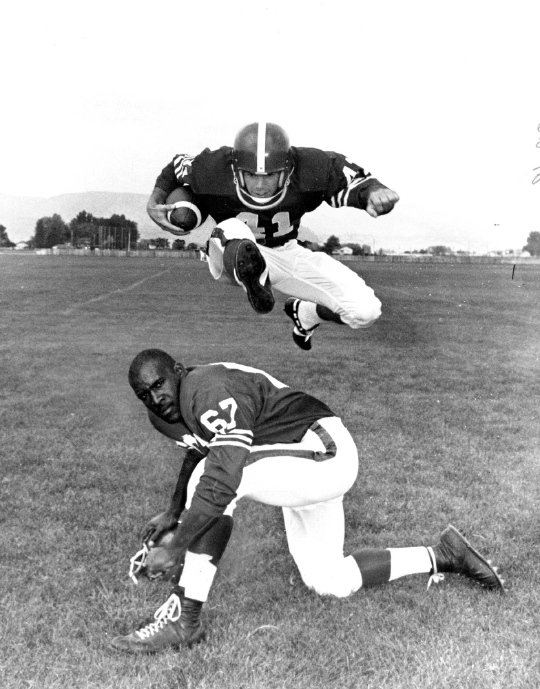 . July 31, 1962: Jerry Tarr, a national collegiate hurdles champion from Oregon, showed linebacker John Hobbs a thing or two during picture day at Broncos camp. (Ira Gay Sealy, The Denver Post)