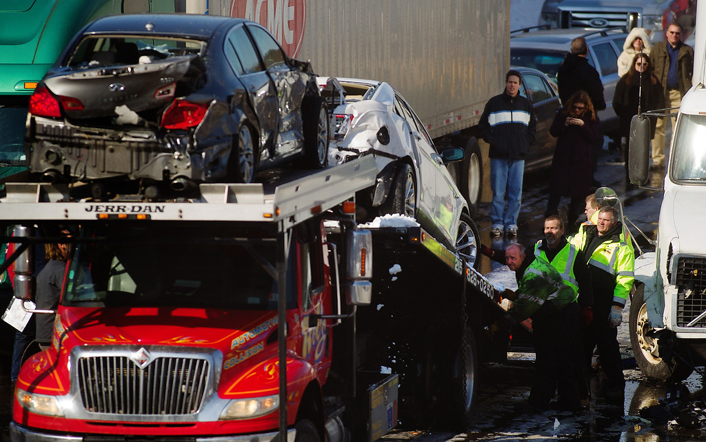 . Emergency responders work to clean up a huge pile up after an accident, Friday, Feb. 14, 2014, in Bensalem, Pa. (AP Photo/Bucks County Courier Times, Bill Fraser )