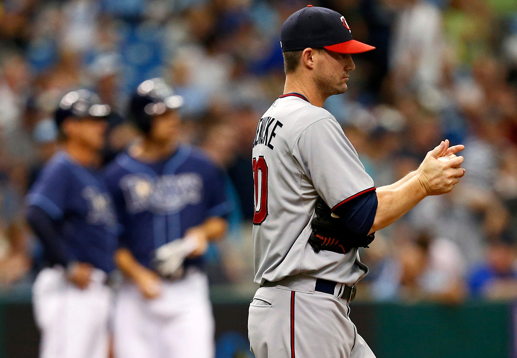 . Twins reliever pitcher Josh Roenicke reacts after giving up a triple to Tampa Bay\'s Ben Zobrist during the seventh inning. (AP Photo/Mike Carlson)