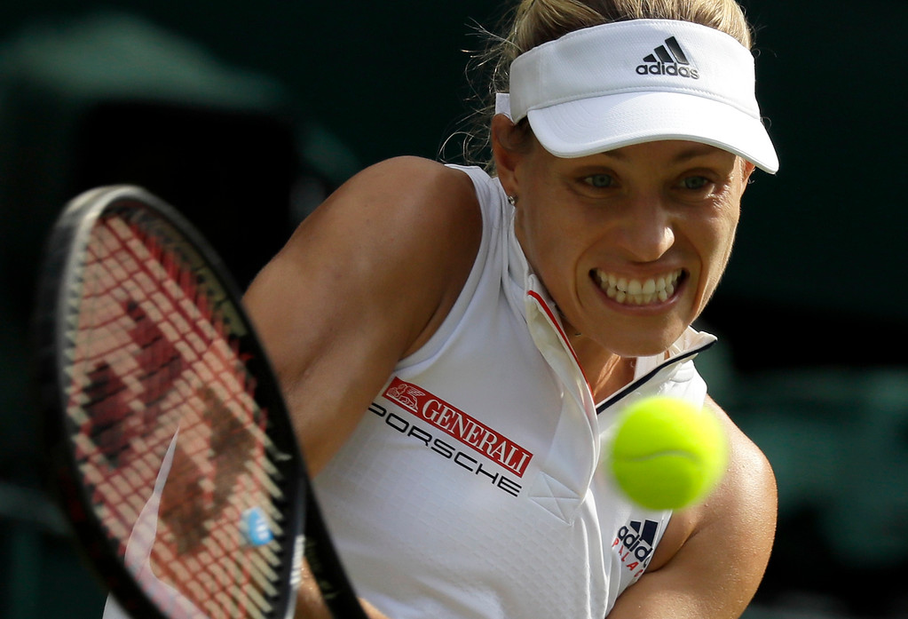 . Germany\'s Angelique Kerber returns the ball to Japan\'s Naomi Osaka during their women\'s singles match, on the sixth day of the Wimbledon Tennis Championships in London, Saturday July 7, 2018. (AP Photo/Kirsty Wigglesworth)
