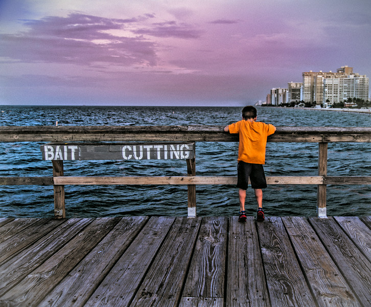 Bait cutting boy in orange.jpg