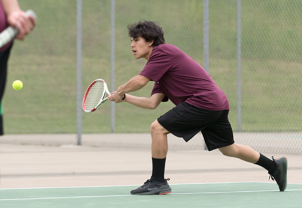 05/09/19 Wesley Bunnell | Staff Newington boys tennis defeated New Britain at New Britain High School on Thursday afternoon. Part of New Britain's number 1 double team. Pedro Garcia.