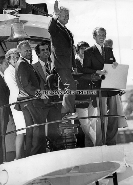 . Oakland, CA July 3, 1980 - President Jimmy Carter waves during a tugboat tour of the Oakland port with city and port officials. (Ron Riesterer / Oakland Tribune Staff Archives)