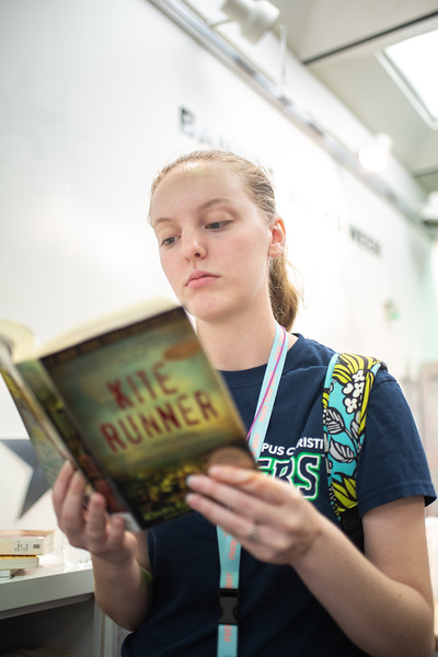 "Sarah McCurdy comes to support Banned Books Week at the Mary and Jeff Bell Library by reading over banned book ""Kite Runner""."