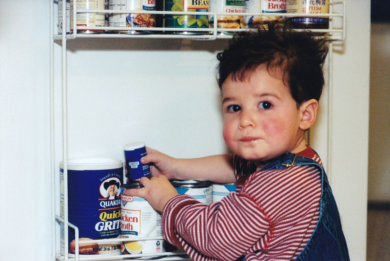 1998-12 Josh inspects the canned goods.jpg