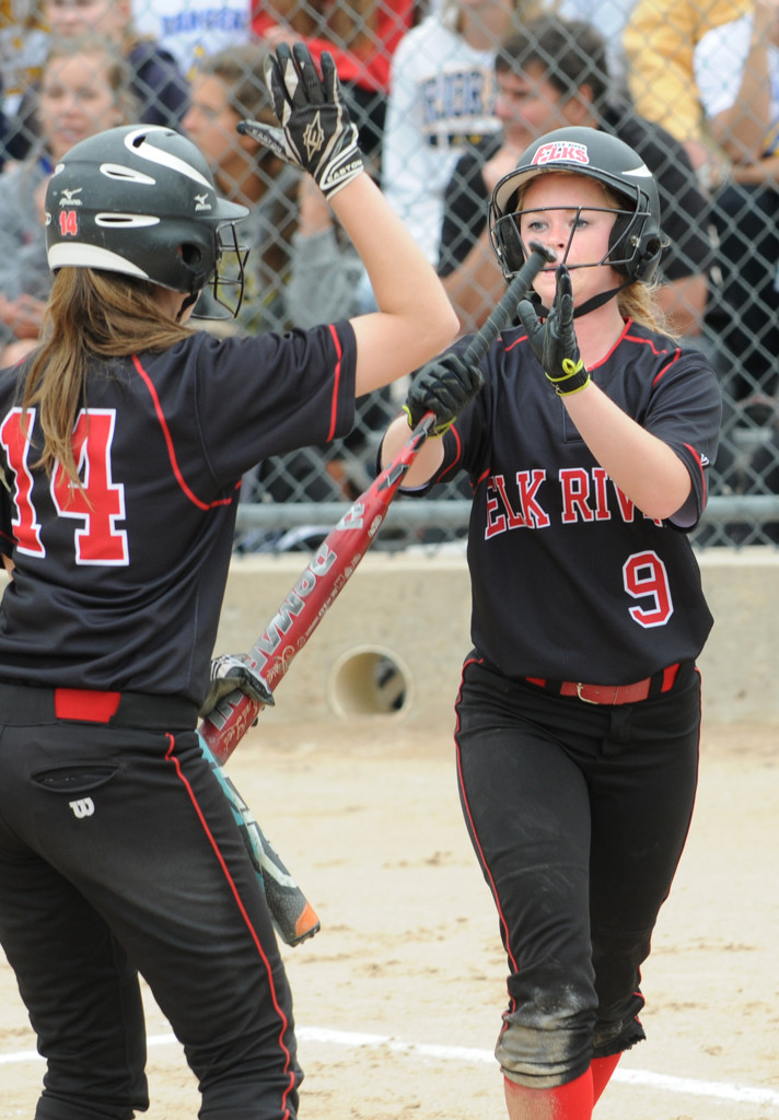 . Elk River\'s Marie Deaton, right, celebrates with teammate Jessica Neuman after scoring their first run against Prior Lake. (Pioneer Press: Jean Pieri)
