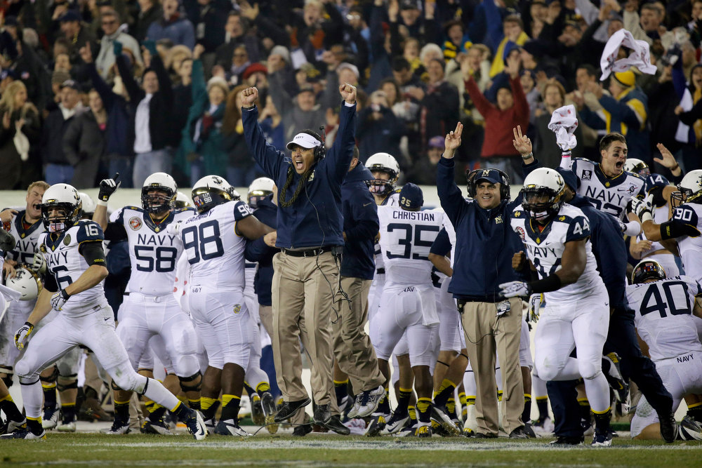 . Navy head coach Ken Niumatalolo celebrates after Navy recovered a fumble by Army in the final minutes of the second half of an NCAA college football game, Saturday, Dec. 8, 2012, in Philadelphia. Navy won 17-13. (AP Photo/Matt Slocum)