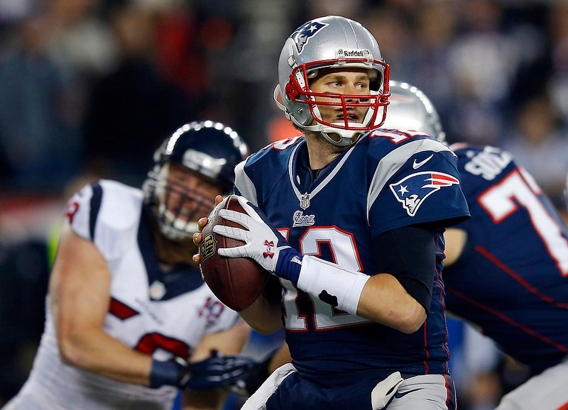 . New England Patriots quarterback Tom Brady looks down field as he prepares to pass during the first quarter of their NFL AFC Divisional playoff football game against the Houston Texans in Foxborough, Massachusetts January 13, 2013