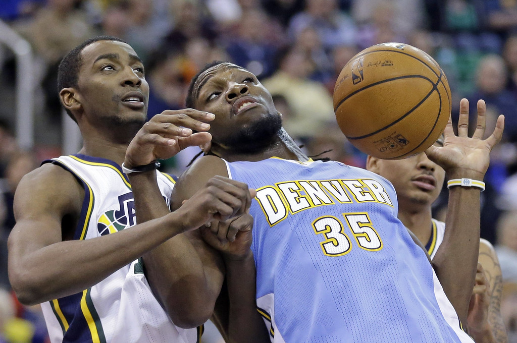 . Utah Jazz\'s Jeremy Evans, left, and Denver Nuggets\' Kenneth Faried (35) battle under the boards for a rebound in the second half during an NBA basketball game Monday, Jan. 13, 2014, in Salt Lake City. The Jazz won 118-103. (AP Photo/Rick Bowmer)