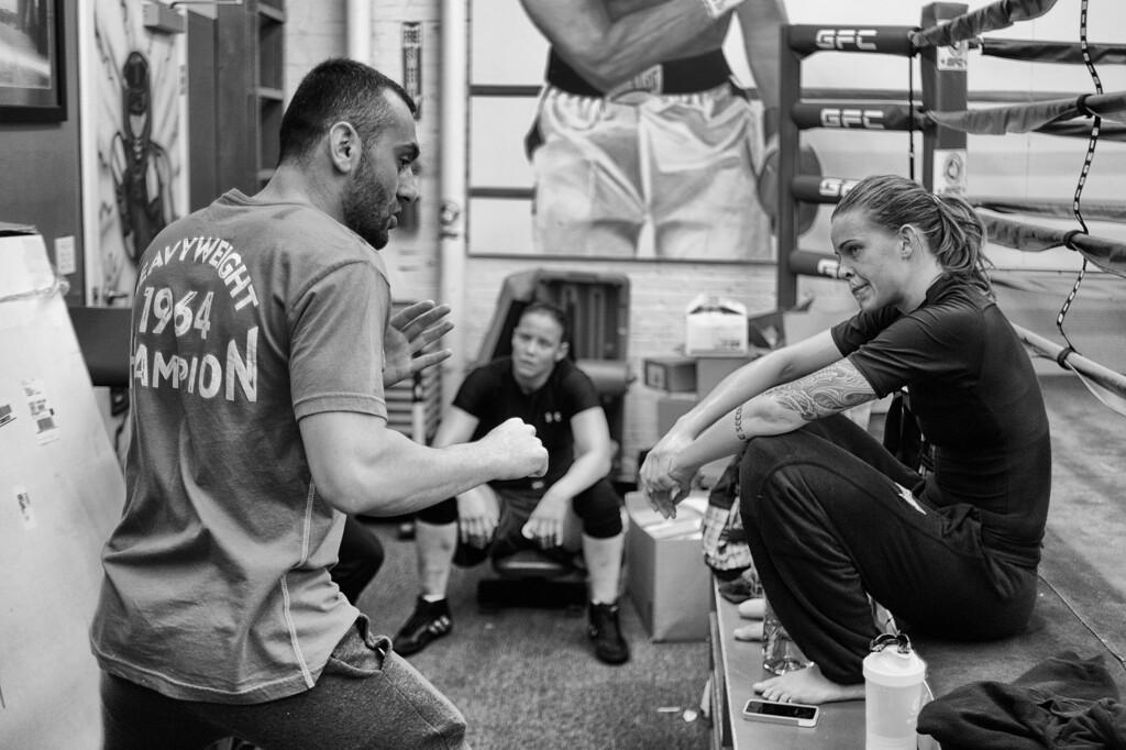 . Jessamyn Duke gets some pointers from coach Edmond Tarverdyan as Shayna Baszler looks on at Glendale Fighting Club in Glendale. (Photo by Hans Gutknecht/Los Angeles Daily News)