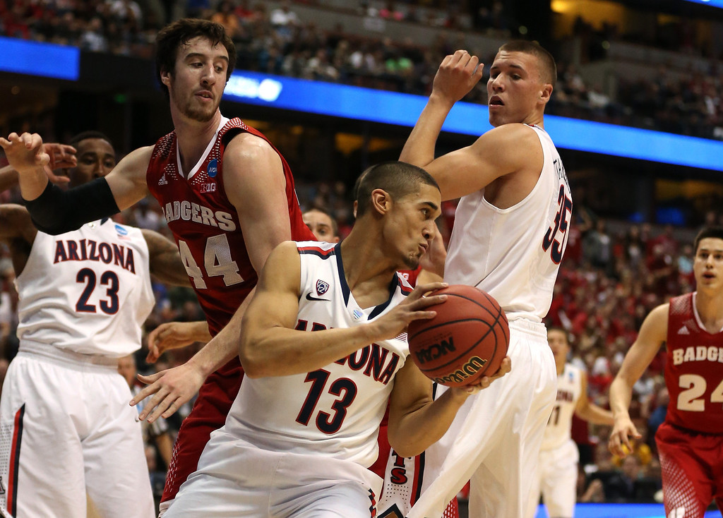 . Nick Johnson #13 of the Arizona Wildcats with the ball against Frank Kaminsky #44 of the Wisconsin Badgers in the first half during the West Regional Final of the 2014 NCAA Men\'s Basketball Tournament at the Honda Center on March 29, 2014 in Anaheim, California.  (Photo by Jeff Gross/Getty Images)