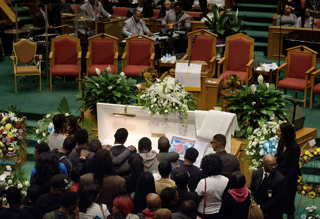 . Mourners pay their respects at the casket of Freddie Gray before his funeral at New Shiloh Baptist Church April 27, 2015 in Baltimore, Maryland. Family members and friends are expected to turn out in large numbers Monday at the funeral of Gray, the 25-year-old black man who died April 19 after an encounter April 12 with police left him with grave spinal injuries.  PHOTO/BRENDAN SMIALOWSKIBRENDAN SMIALOWSKI/AFP/Getty Images