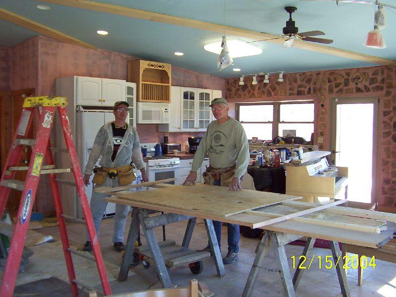 Beemer John, and Hank doing trim work.
