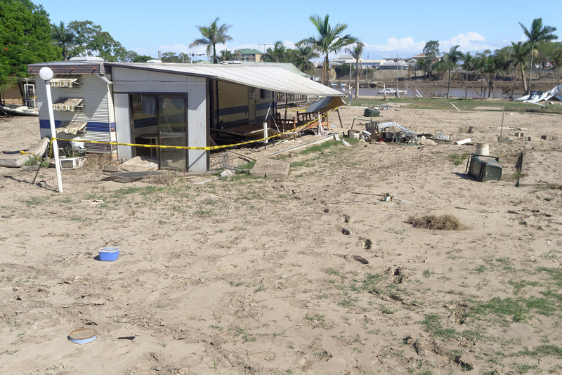 The remains of a on-site permanent home in the Riverdale Caravan Park, with one set of footprints leading to it, obviously made when the mud was still thick and wet.