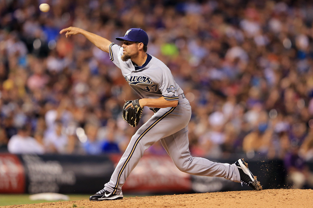 . DENVER, CO - JULY 26:  Pitcher Rob Wooten #47 of the Milwaukee Brewers delivers against the Colorado Rockies at Coors Field on July 26, 2013 in Denver, Colorado.  (Photo by Doug Pensinger/Getty Images)