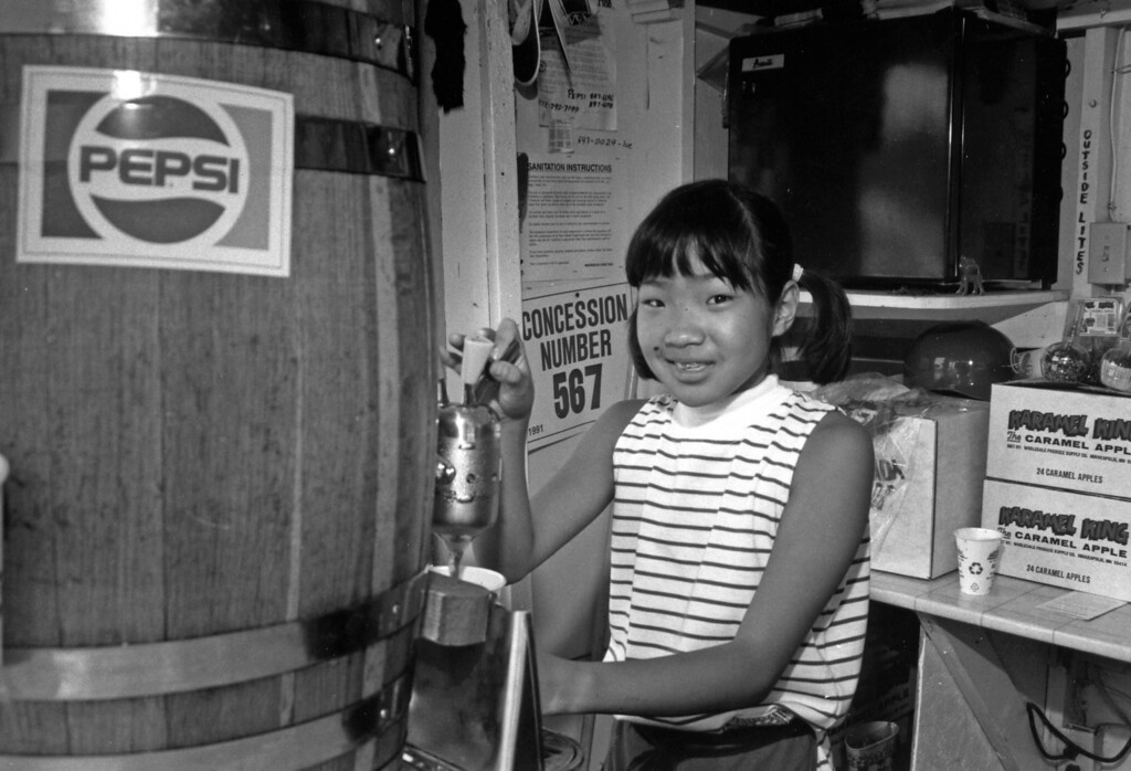 . A girl dispenses some Pepsi at a concession stand during the 1991 Minnesota State Fair. Photo courtesy of the Minnesota State Fair.