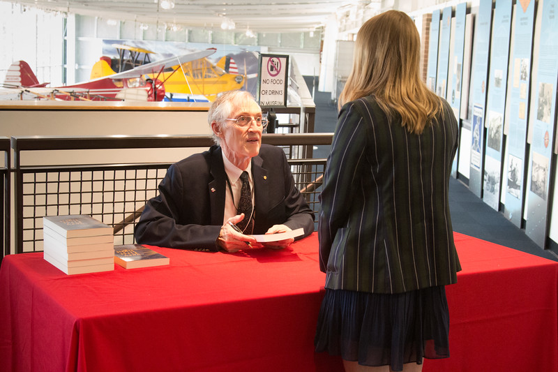 "Alyson Barker Joens (2018 Scholar) with John Mather, as he signs copies of his book ""The Very First Light"" -- An award luncheon, ""Dr. John Mather Nobel Scholars Program Award"", as part of the National Space Grant Foundation. College Park Aviation Museum, College Park, MD, August 2, 2019."