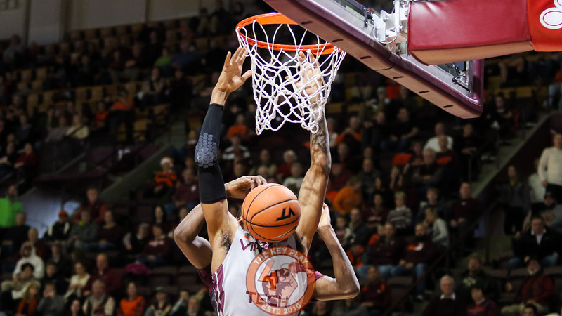 Nickeil Alexander-Walker attempts to dunk the basketball but is fouled from behind. (Mark Umansky/TheKeyPlay.com)