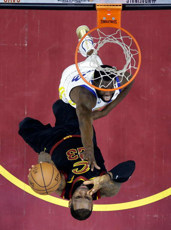 . Cleveland Cavaliers\' LeBron James shoots against Golden State Warriors\' Draymond Green during the first half of Game 3 of basketball\'s NBA Finals, Wednesday, June 6, 2018, in Cleveland. (AP Photo/Carlos Osorio, Pool)