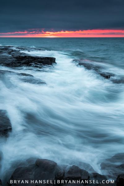 Waves on Basalt at Sunrise