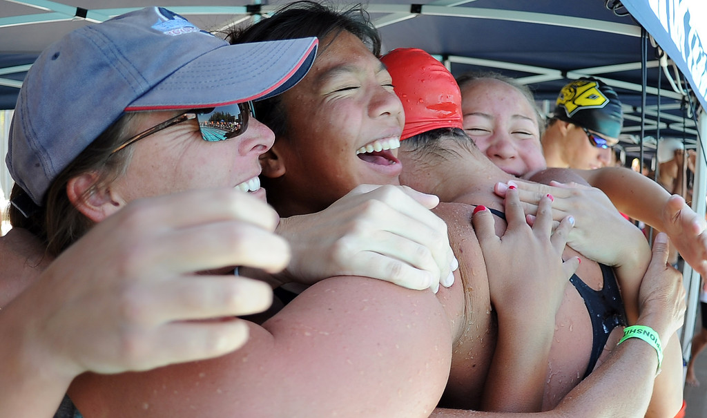 . Glendora\'s Nicole Gautreau is mobbed by teammates after winning the 500 freestyle during the CIF-SS Division II swim finals at Riverside City College on Saturday, May 11, 2013 in Riverside, Calif.  (Keith Birmingham Pasadena Star-News)