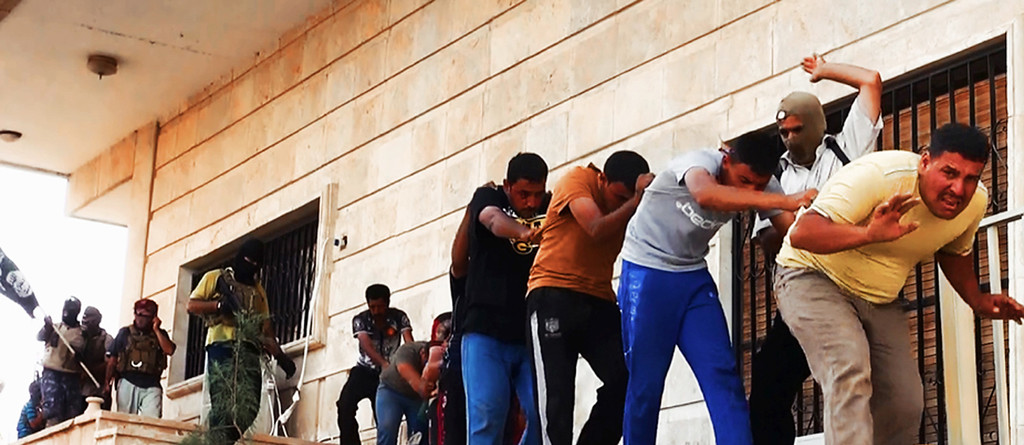. This image posted on a militant website on Saturday, June 14, 2014, which has been verified and is consistent with other AP reporting, appears to show militants from the al-Qaida-inspired Islamic State of Iraq and the Levant (ISIL) leading away captured Iraqi soldiers in plain clothes after taking over a base in Tikrit, Iraq. The Islamic militant group that seized much of northern Iraq has posted photos that appear to show its fighters shooting dead dozens of captured Iraqi soldiers in a province north of the capital Baghdad. Iraq\'s top military spokesman Lt. Gen. Qassim al-Moussawi confirmed the photosí authenticity on Sunday and said he was aware of cases of mass murder of Iraqi soldiers. (AP Photo via militant website)