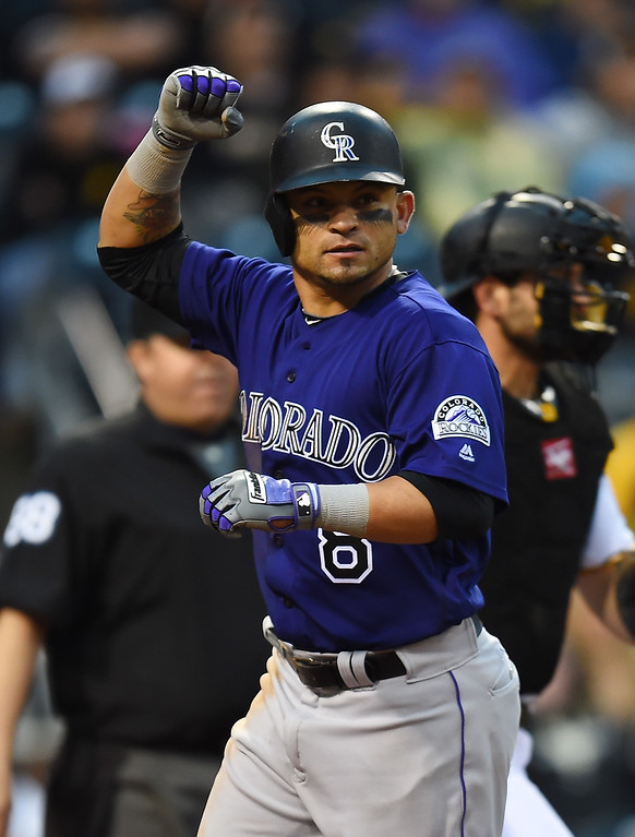 . PITTSBURGH, PA - MAY 21:  Gerardo Parra #8 of the Colorado Rockies celebrates after scoring during the ninth inning against the Pittsburgh Pirates on May 21, 2016 at PNC Park in Pittsburgh, Pennsylvania.  (Photo by Joe Sargent/Getty Images)