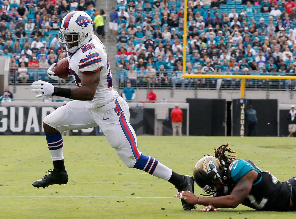 . Winston Guy #22 of the Jacksonville Jaguars attempts turnover tackle  C.J. Spiller #28 of the Buffalo Bills during the game at EverBank Field on December 15, 2013 in Jacksonville, Florida.  (Photo by Sam Greenwood/Getty Images)