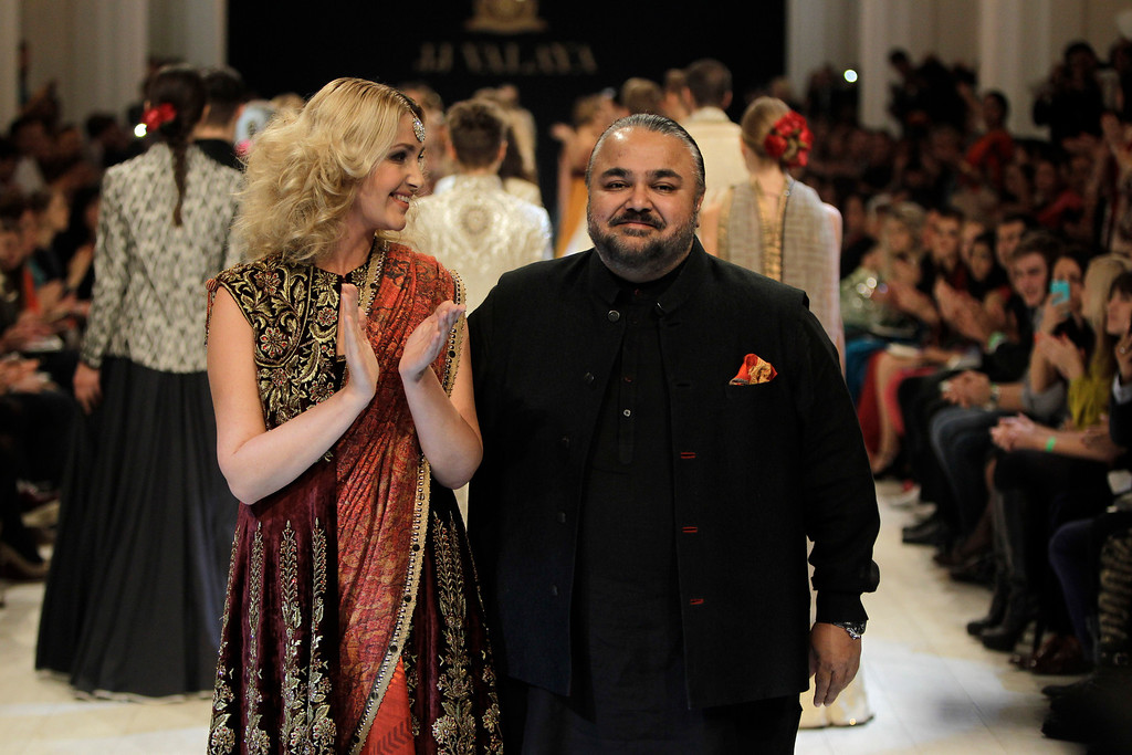 . Indian fashion designer JJ VALAYA, right, poses during a Fashion Week event in Kiev, Ukraine, Sunday, Oct. 13, 2013. (AP Photo/Sergei Chuzavkov)