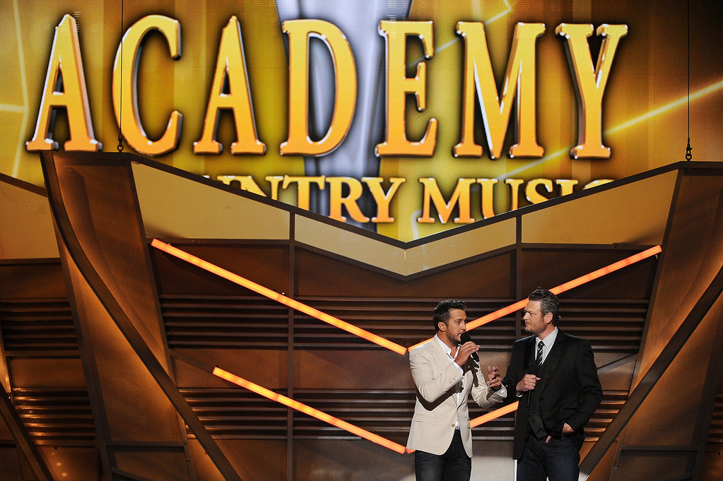 . Hosts Luke Bryan, left, and Blake Shelton speak on stage at the 49th annual Academy of Country Music Awards at the MGM Grand Garden Arena on Sunday, April 6, 2014, in Las Vegas. (Photo by Chris Pizzello/Invision/AP)