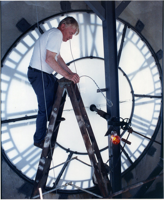 . David Moore climbs down after replacing some of the cables for the bell chime in the Lakeland Community College clocktower on Aug. 18, 1993. The bell chime did not work for three weeks as a cable broke to the bell. More was inside the clocktower to fix the bell. (News-Herald file)