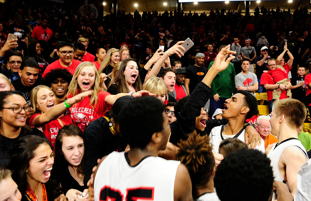 . Eaglecrest students and players celebrate after their win at the Coors Events Center on March 11, 2016 in Boulder, Colorado. Eaglecrest defeated Rangeview 58-55 to advance to the 5A finals of the Colorado state high school basketball tournament.  (Photo by Brent Lewis/The Denver Post)